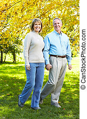 Happy senior couple - Happy senior couple walking at the...