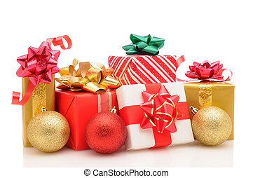 Christmas presents and ornaments on white - Group of wrapped...
