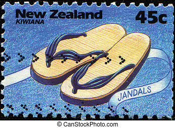 jandals - NEW ZEALAND - CIRCA 1994: A stamp printed in New...