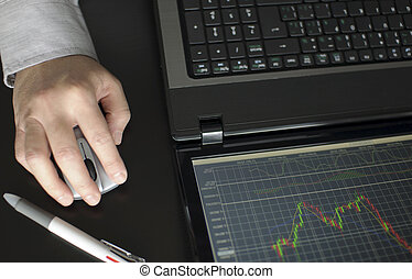 Stock diagram on the screen - Business man checking stock...