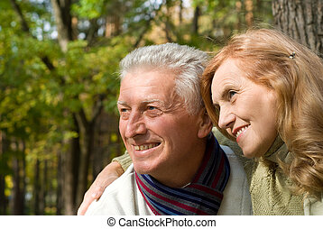 two old people at nature - happy old couple posing in the...