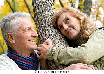 happy old couple at forest - happy old couple posing in the...