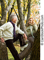 two elderly people at forest - happy old couple posing in...