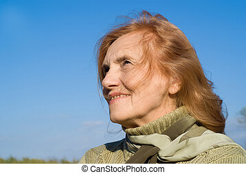 old woman at sky