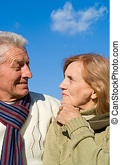 aged couple at sky - cute old couple posing with the sky on...