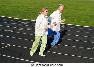 old people running at the stadium