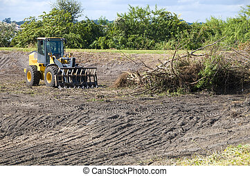Brush clearing - Clearing brush with a heavy loader for a...