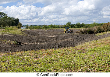Retention pond - Clearing land of brush and creating a...