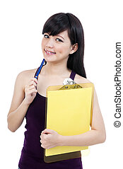 Cute Young Female Student Holding Clipboard And Pen -...
