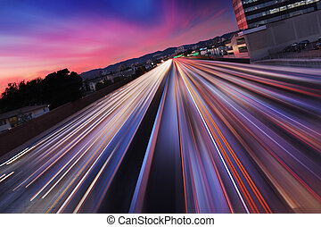 Freeway at night - Traffic at twilight on 405 freeway in Los...