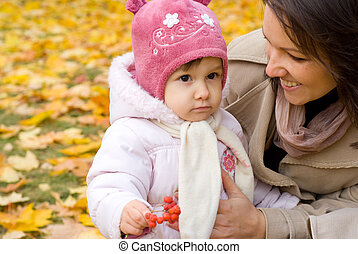 mom and child at nature - portrait of a cute mom with...