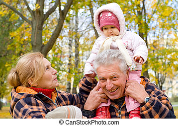 grandparents with children at nature - portrait of a cute...