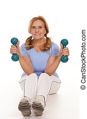 elderly woman with dumb bells - cute aged woman with dumb...