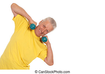 old sportsman in yellow - pretty old man with dumb bells on...