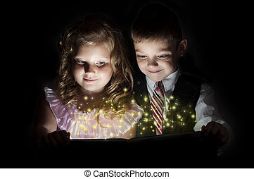 boy and girl discover a magic book, magic inside