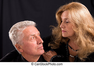 elderly couple on black - cute old man and woman posing on...