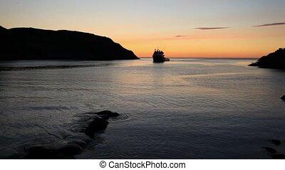 Entering Port - Supply vessel entering port at sunrise.