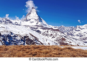 Landscape of Matterhorn peak with dry meadow located at Gornergrat in Switzerland