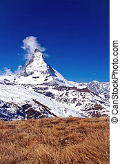 Landscape of Matterhorn peak with dry meadow located at...