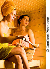 sauna - portrait of young woman in the sauna