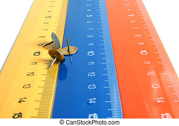 Rulers - Colour rulers with pushpins isolated on the white...