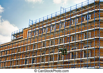 Houses in scaffold