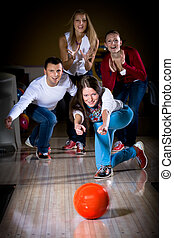 bowling - a young woman playing bowling