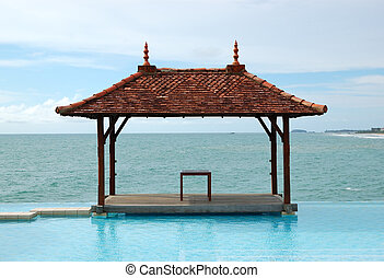 Traditional style hut at the sea view swimming pool,...