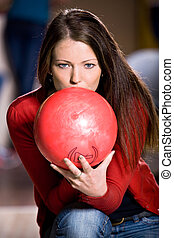 bowling girl - a young woman playing bowling