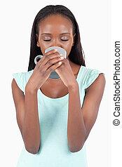 Woman enjoying a sip of tea