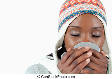 Young woman enjoying a cup of tea in the cold