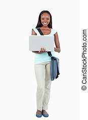 Smiling young student with her notebook