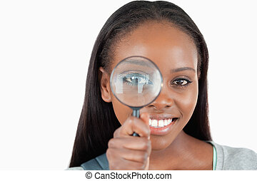 Young woman with magnifier