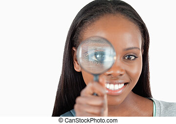 Smiling woman with magnifier