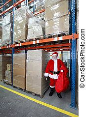 Santa Claus ready for Christmas - waiting in storehuse