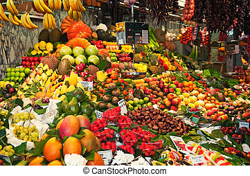 Colourful fruit and vegetable market stall in Boqueria...