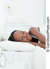 Portrait of a woman sleeping against a white background