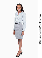 Portrait of a businesswoman standing up against a white...