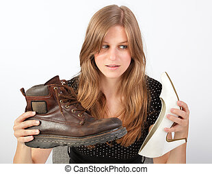 Girl holding male and female shoe - Young blond excited...