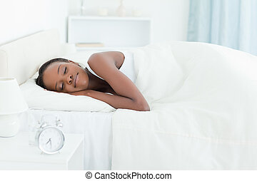 Calm woman sleeping in her bedroom