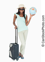 Young woman going on a world tour against a white background