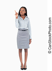 Portrait of a businesswoman pointing at a copy space against...