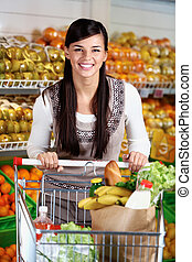 Female with cart - Image of pretty woman with cart looking...