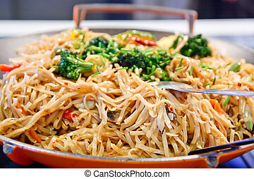 Asian Noodle Stir-Fry with Broccoli - A wok full of stir...