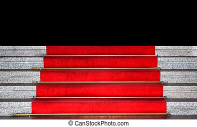 Red carpet on marble stairs leading to darkness