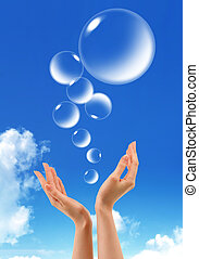 Hand hold Bubbles in the sky  - Hand hold Bubbles in the sky