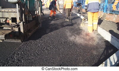 Laying of asphalt. Russia