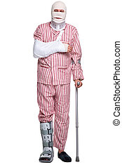 Injured man walking on crutches - Photo of an injured man...