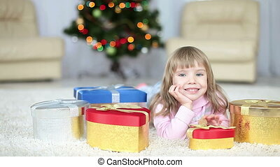 Child with a gifts lying on the