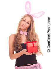 A girl dressed as a rabbit with gifts studio shooting